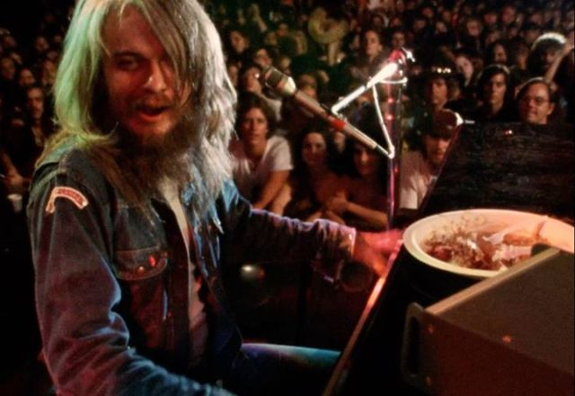 Leon Russell on stage with food