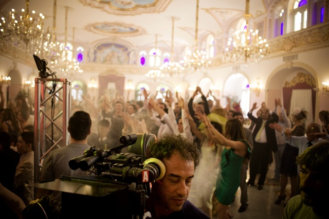 "Matteo Garrone (foreground) shooting ""Reality"""